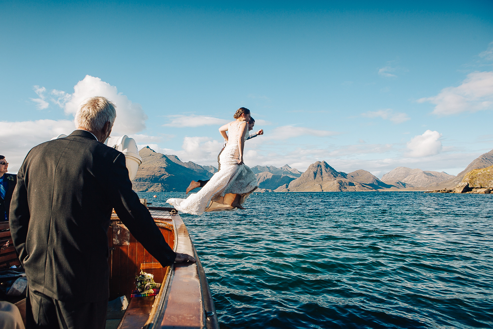 Bride and Groom aboard Misty Isle Loch Coruisk Elopement jumping into sea