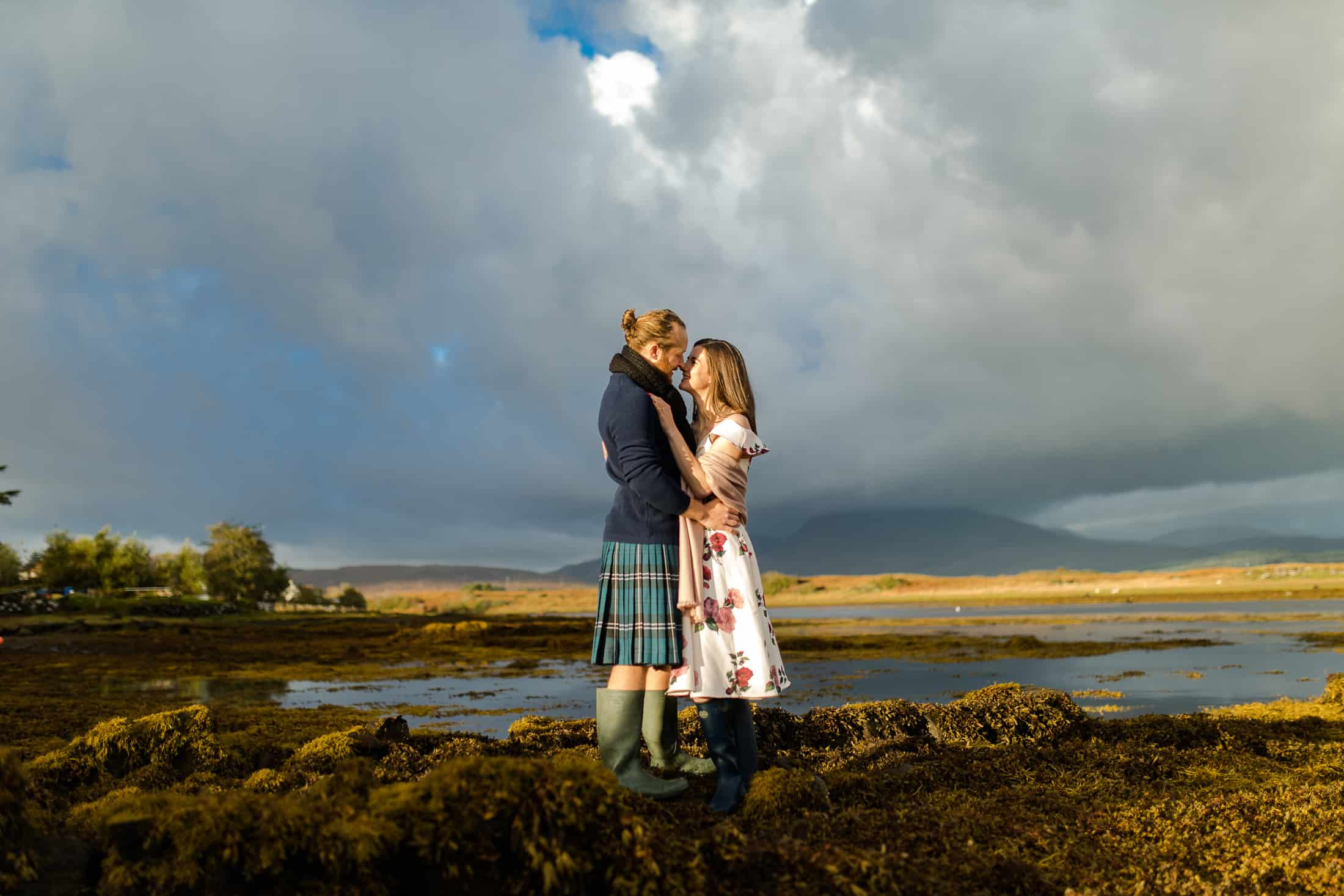 Engagement photoshoot on beach with mountains Isle of skye