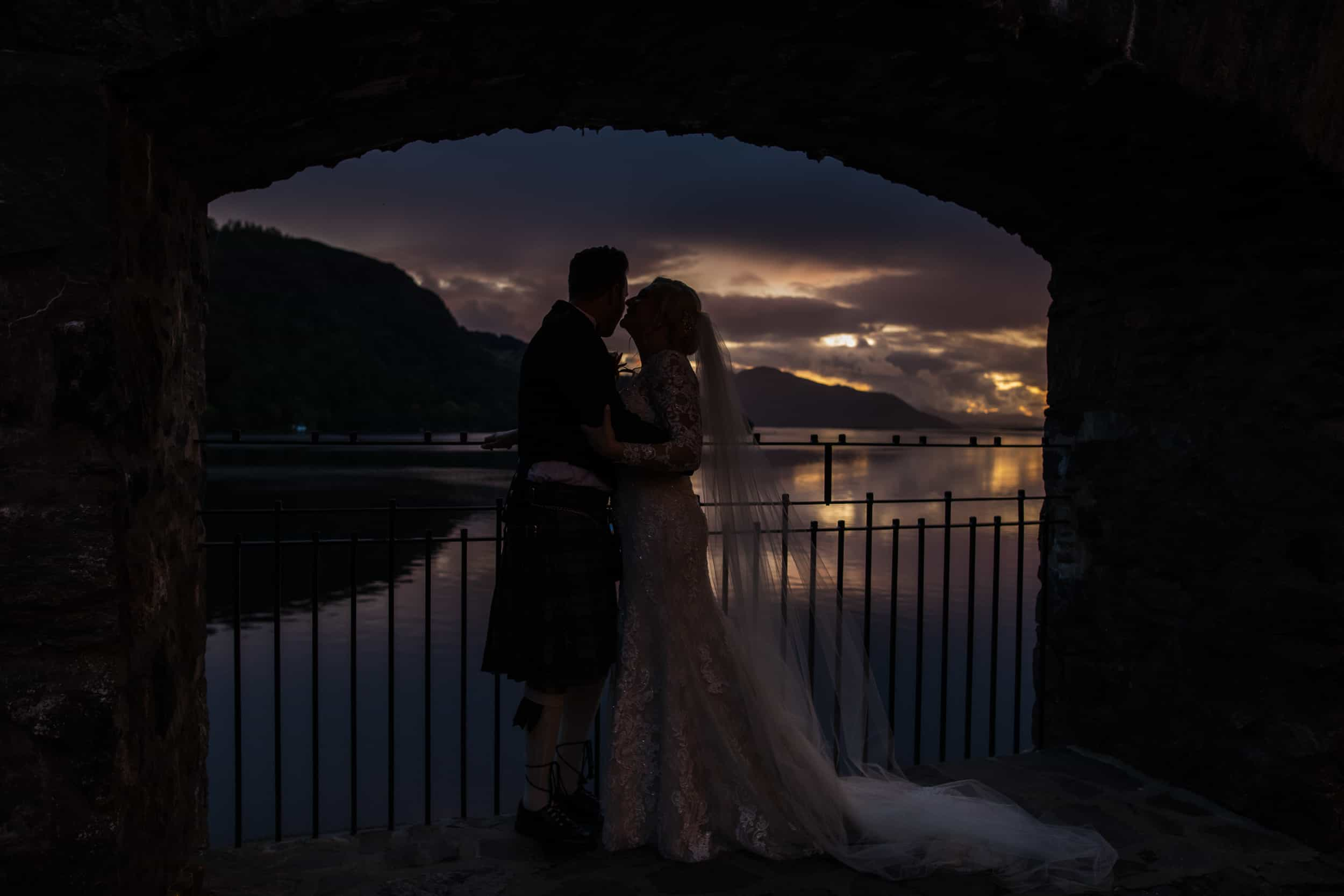 Bride and groom sunset Eilean Donan Castle