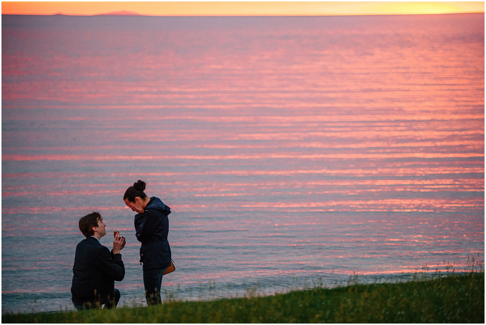 young man proposes to girlfriend at Coral beach Isle of Skye sunset lit sea in background