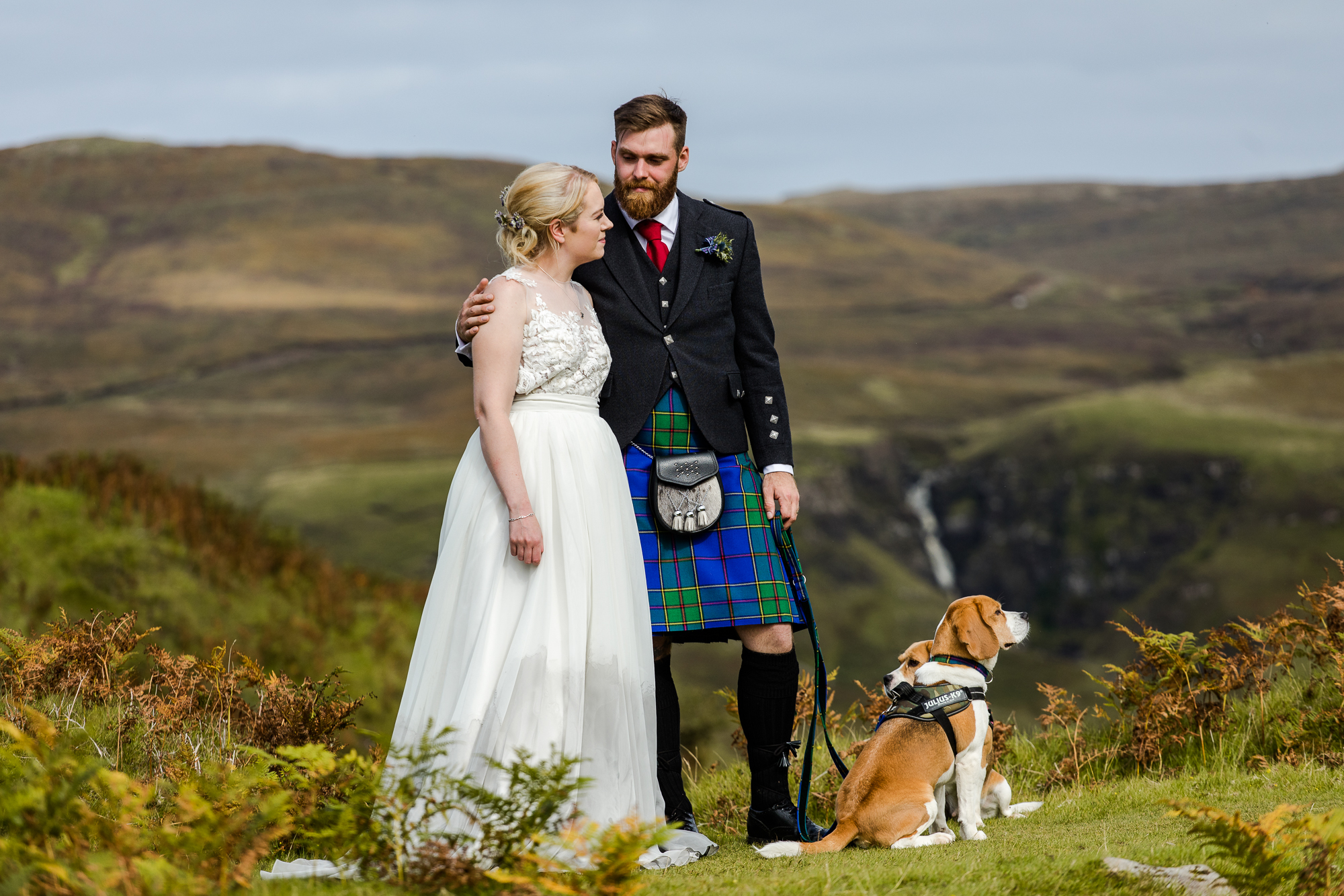 Bride and groom hiking with dogs Fairy Glen Isle of Skye Elopement