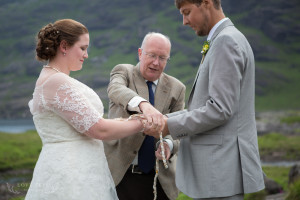 Celebrant performs hand fasting ritual with bride and groom Skye