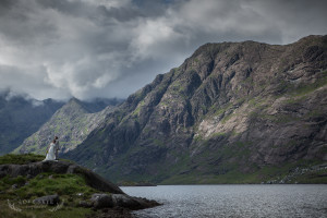 bride and groom standing at edge of Loch Coruisk