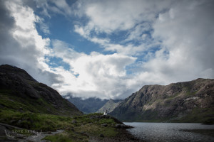 Wide view of Loch Coruisk with very small wedding couple in centre of image