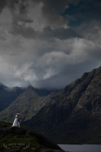 Bride and groom dance and embrace beside Loch Coruisk and Dubh ridge background