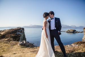 Bride and groom evening wear sunny day at Dunscaith Castle, Isle of Skye elopement