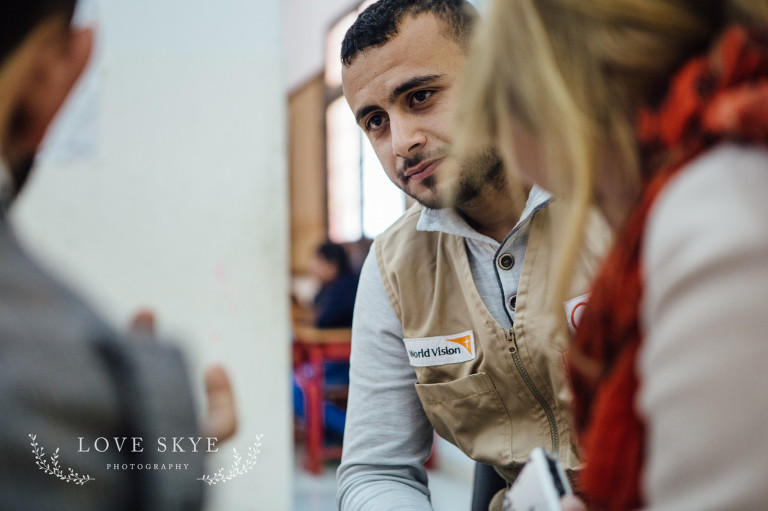 World Vision project teacher remedial school in Jordan for Syrian refugees with two female journalists Iribid north of Amman