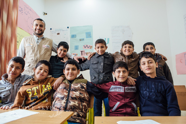Class of Syrian refugee boys at remedial school in Jordan with World Vision project teacher