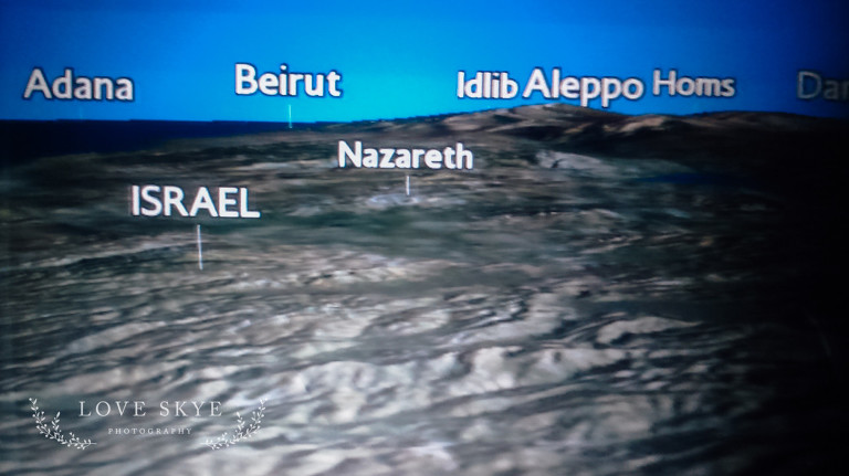 airline seatback screen of Israel, Jordan and Syria showing locations of Aleppo , Homs, Nazareth and Beirutjordan, syria, refugee, world vision, barefootcoatless