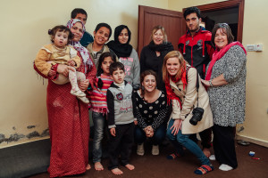 Group photo of Syrian refugees living in community in Jordan with visitors from World Vision