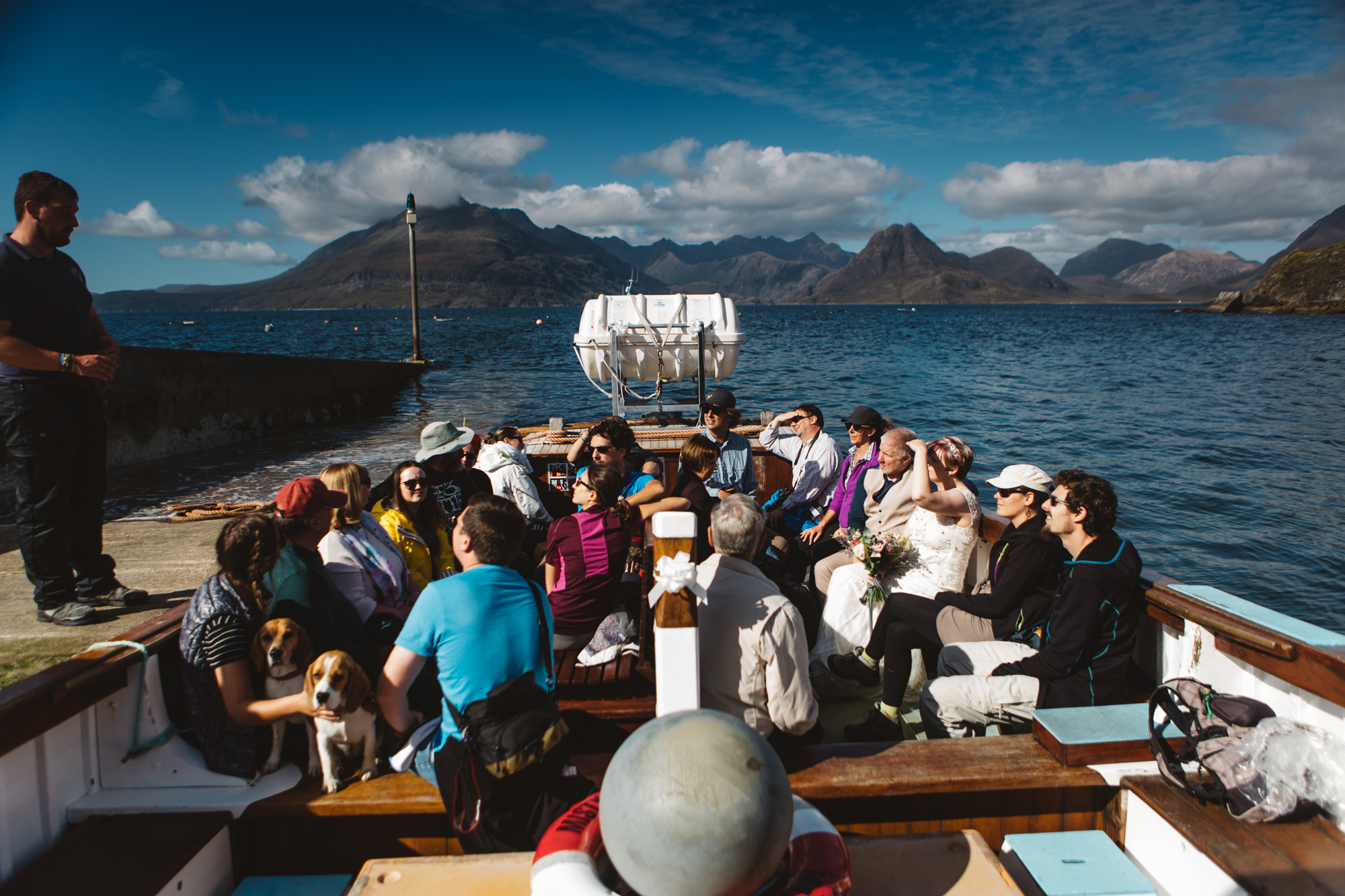 Passengers aboard Misty Isle Elgol sunny day view to Cuillin