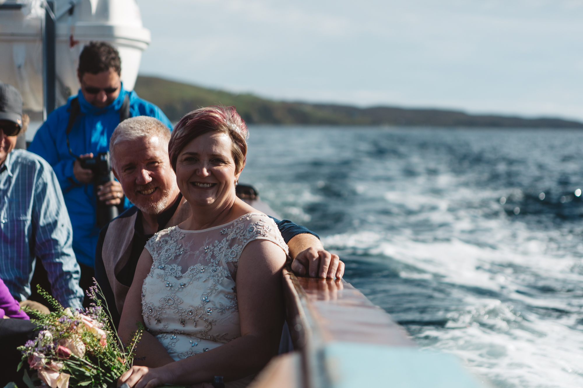 Bride and groom at sea aboard Misty Isle boat