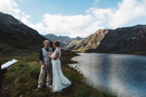 Bride and groom exchange vows during wedding ceremony loch coruisk
