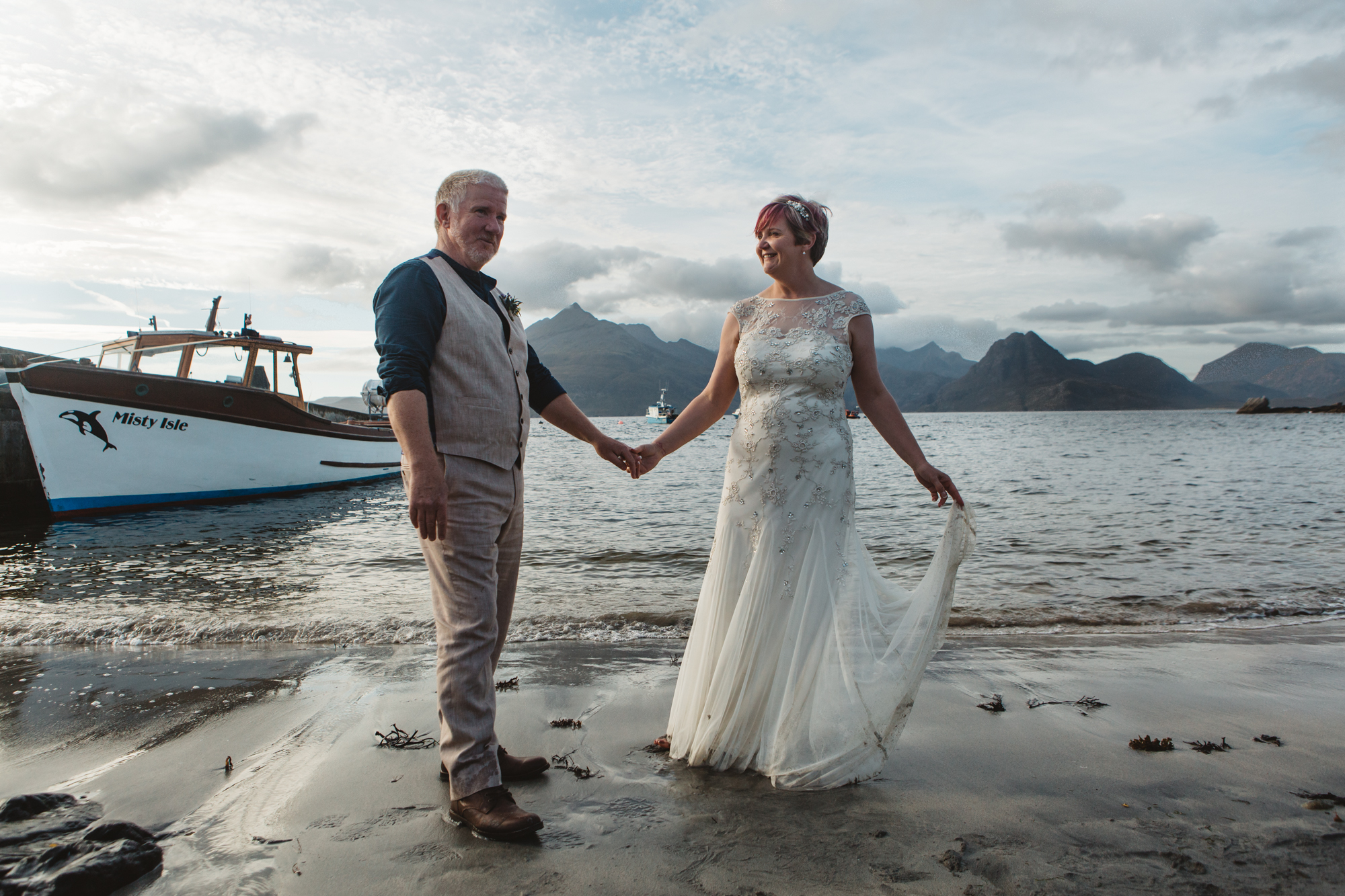 Bride and groom on beach at Elgol Misty Isle and Cuillin