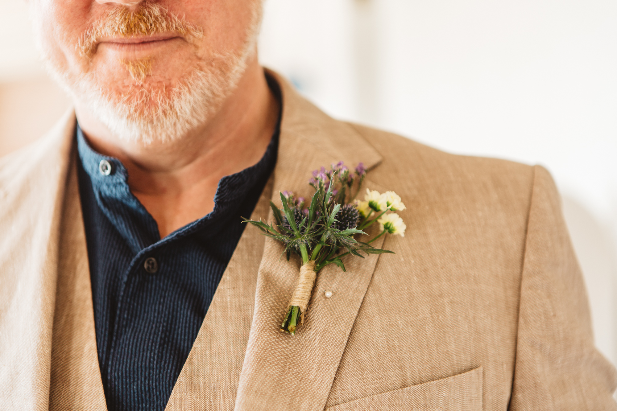 handmade buttonhole with twine finish