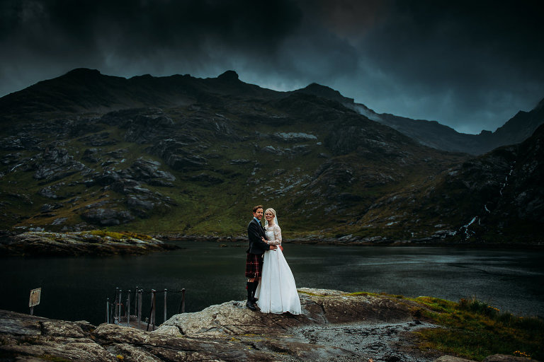 Bride and Groom at Landing steps Loch Na Culice Isle of Skye