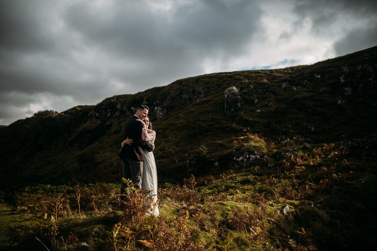Bride and groom in autumn light and bracken at Fairy Glen Isle of Skye