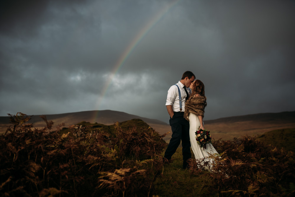 Rainbow over young bride and groom in Fairy Glen Isle of Skye autumn colours