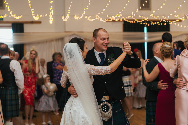 Bride and groom first dance village hall fairy lights Uist wedding photography