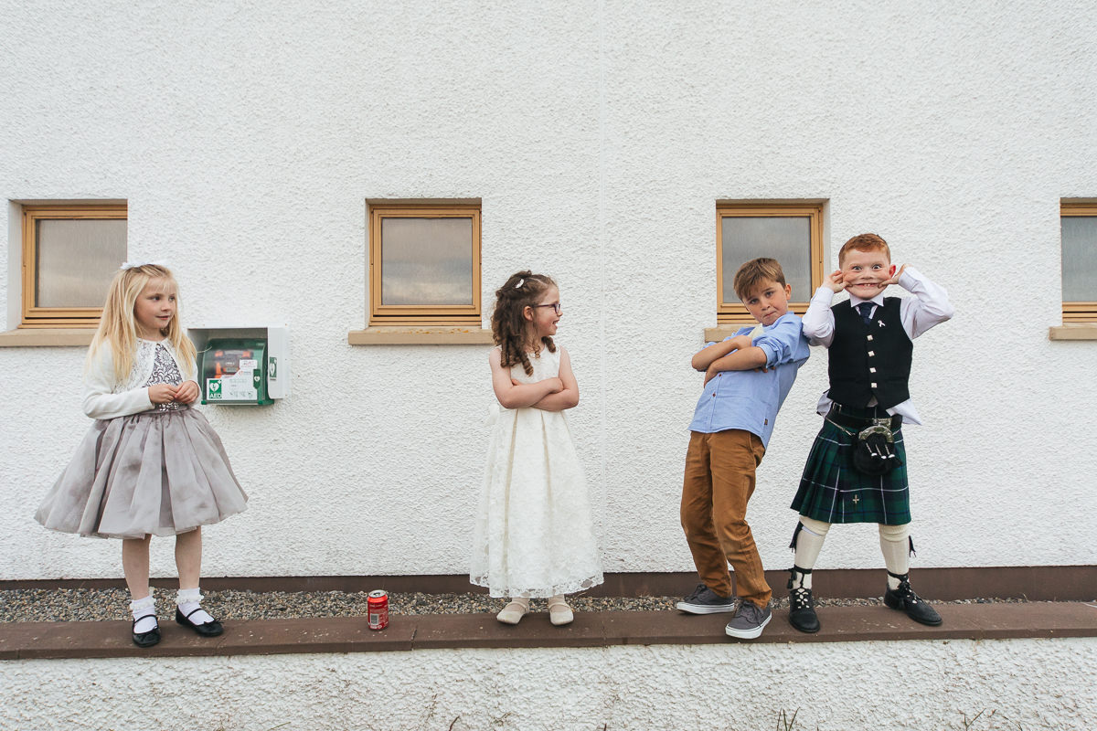 young children pose for the camera outside village hall North Uist