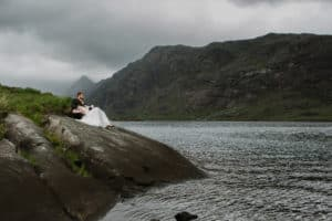 Loch Coruisk couple sitting on rocks